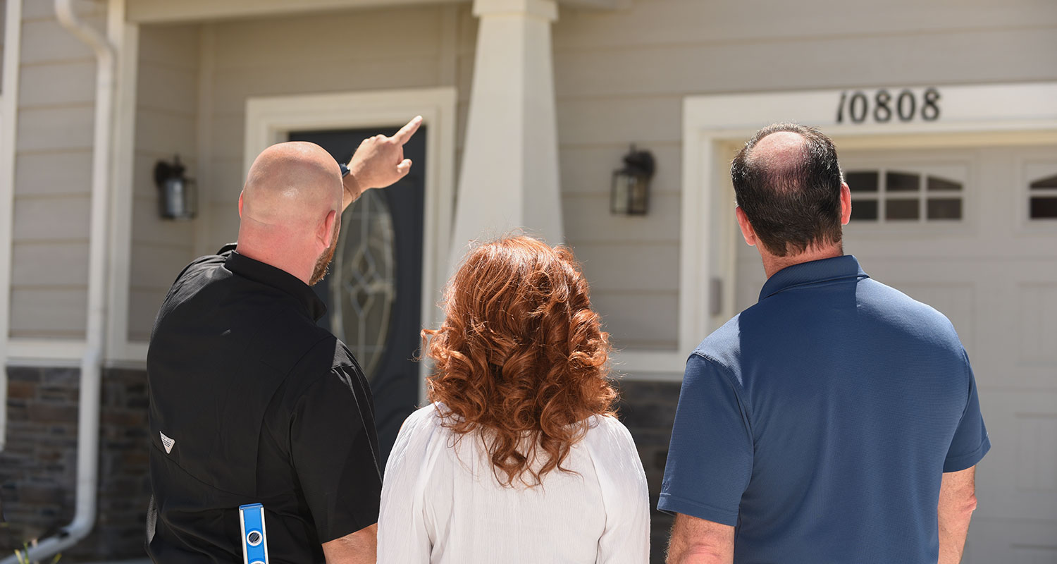 Tom, showing homeowners their home during a home inspection
