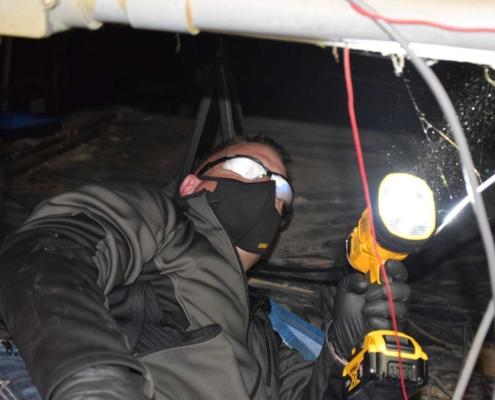 Jordan Phelps Diamond Pro checking Crawlspace